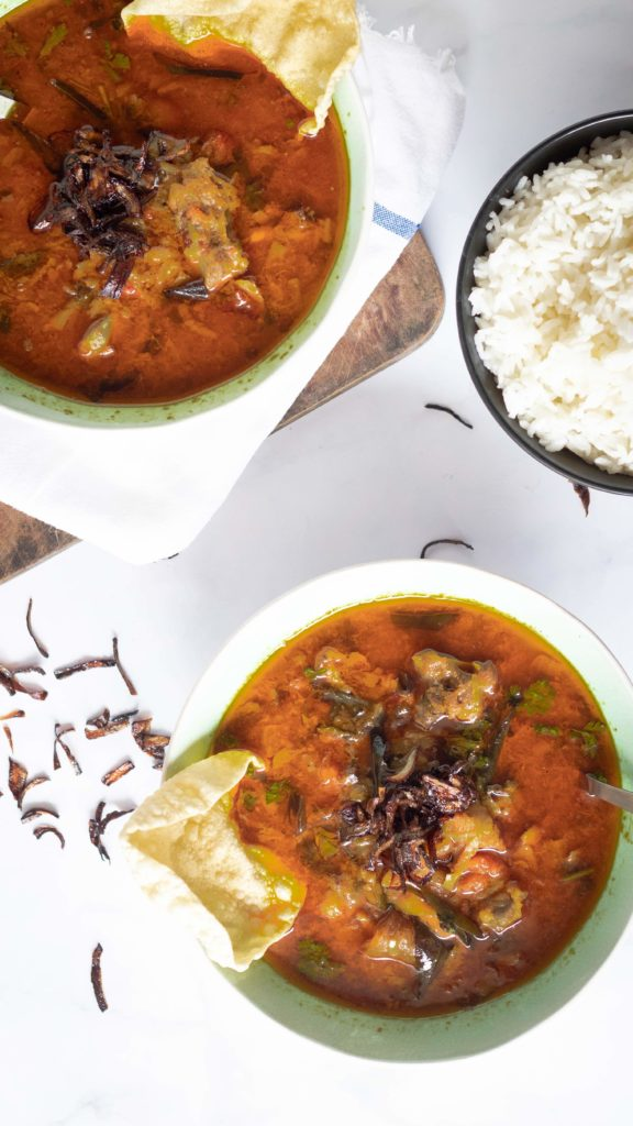 Naatu kozhi rasam, food pbotography, served with rice and crispy fried onions