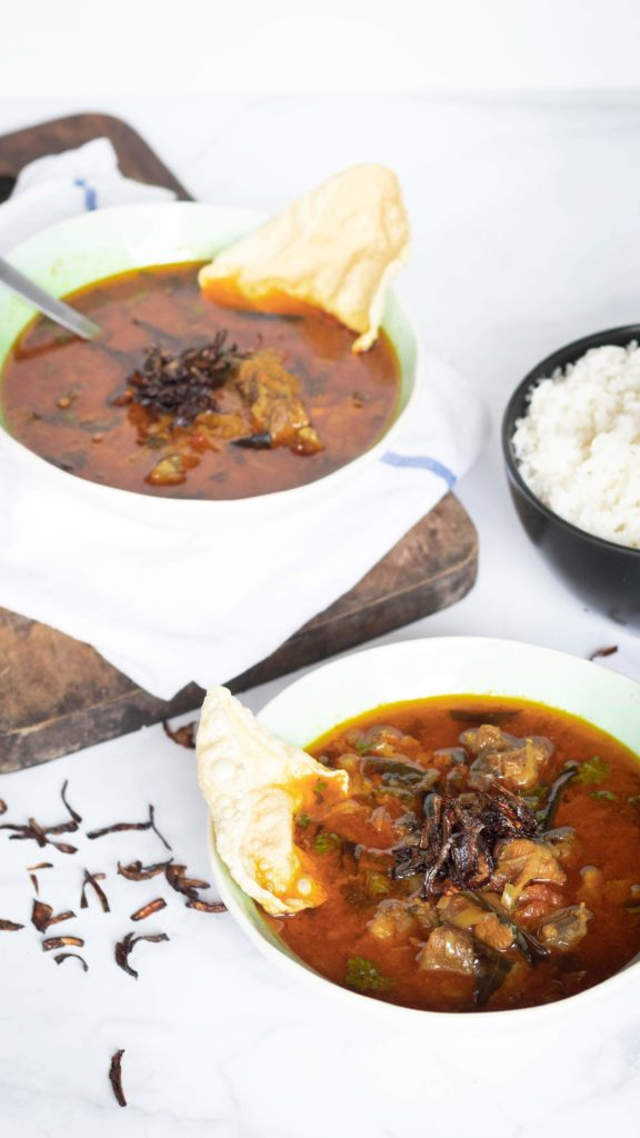 Rustic chicken soup, food pbotography, served with papad and rice
