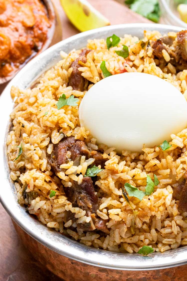 egg on lamb rice south indian style bowl
