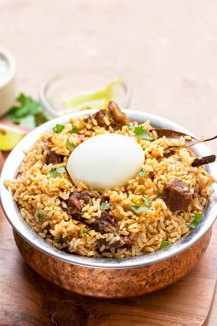 lamb rice in a bowl with egg