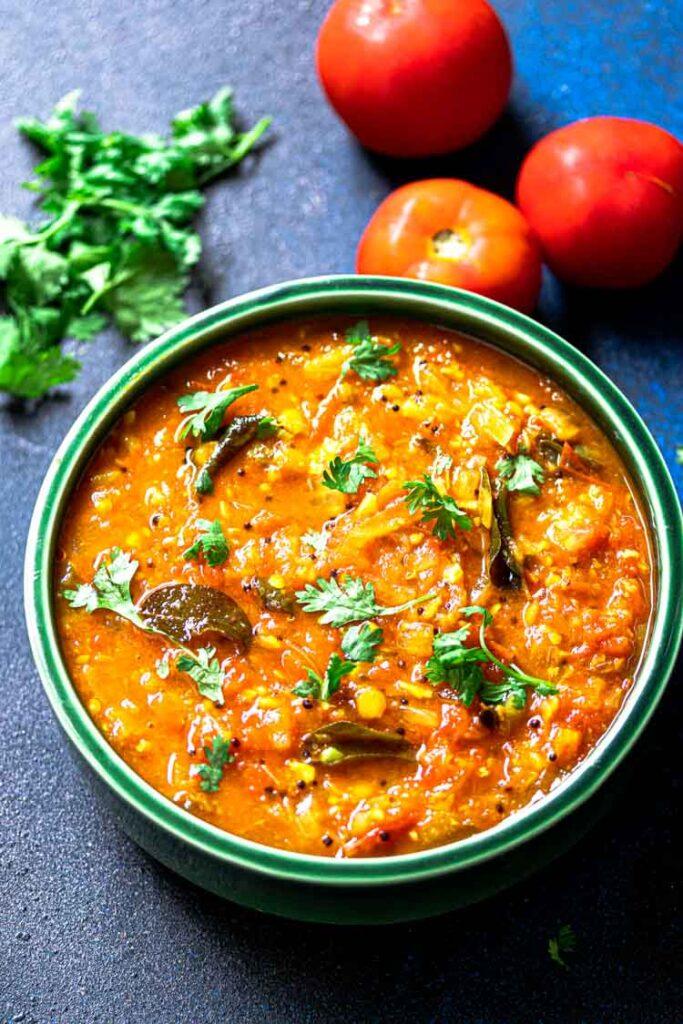 Thakkali Bajji served in a green ceramic bowl, Tomato Chutney food photography