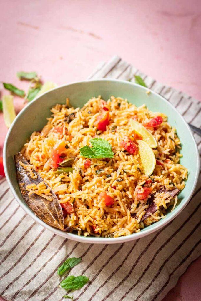 recipe for tomato rice, tomato biryani served in a bowl