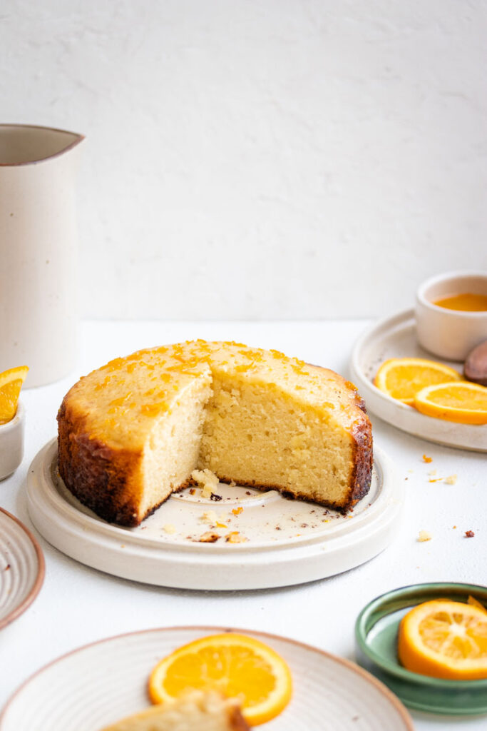 Yogurt Cake on a plate with a few slices removed