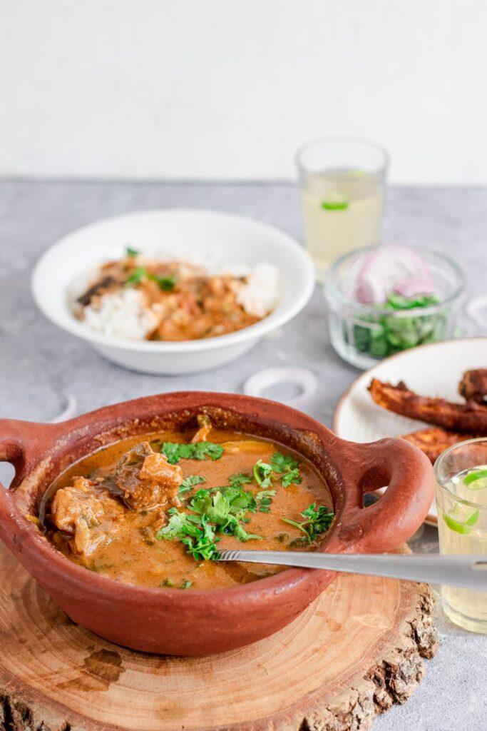 Mutton kuzhambu in a bowl, south indian mutton kulambu, mutton kuzhambu