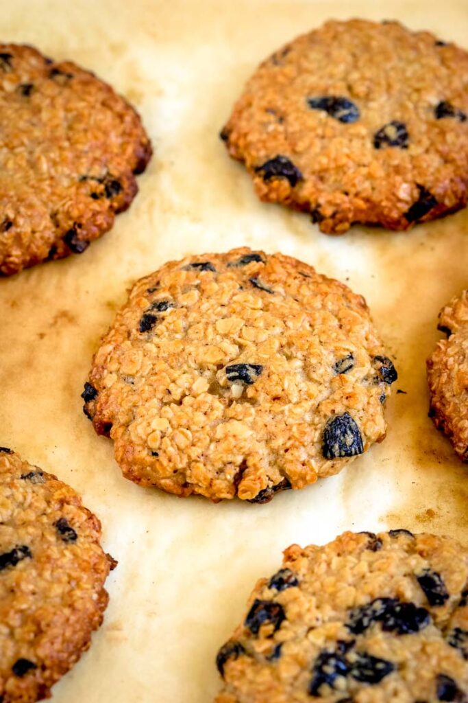 Oatmeal cookies spread on a parchment paper