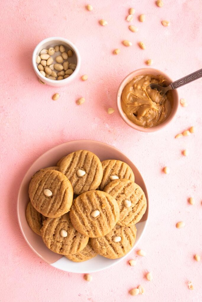 Peanut Butter Cookies stacked on a plate, Top Down Photo of cookies on a plate, peanut butter, peanuts