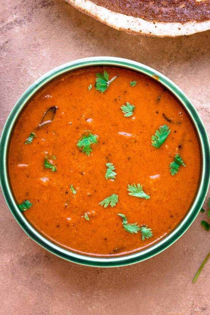 tomato kulambu / south indian thakkali kuzhambu in a bowl
