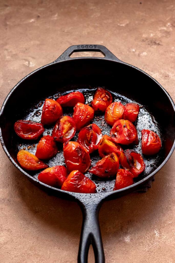 roasted tomatoes in cast iron skillet